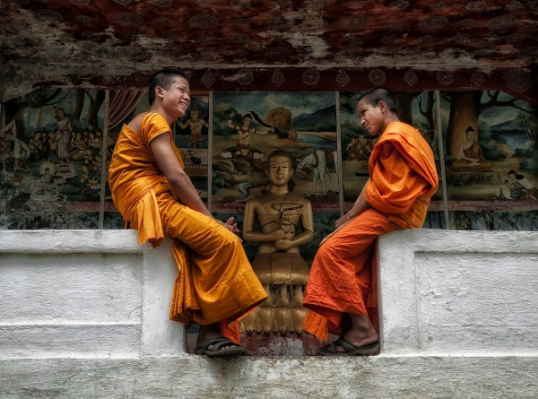 two monks infront of mural,laos-X2